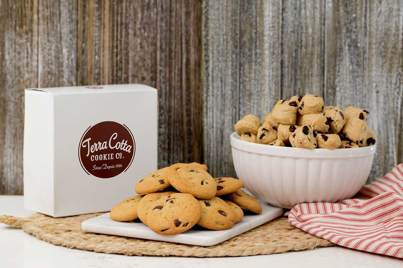 Cookies are present on a plate with a box nearby labelled 'Terra Cotta Cookie Co.'